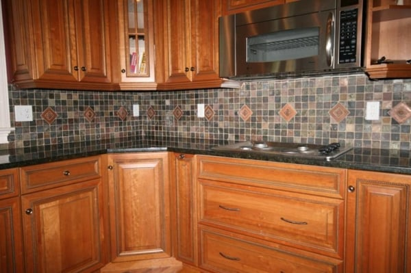 kitchen remodel featuring granite countertops slate tile