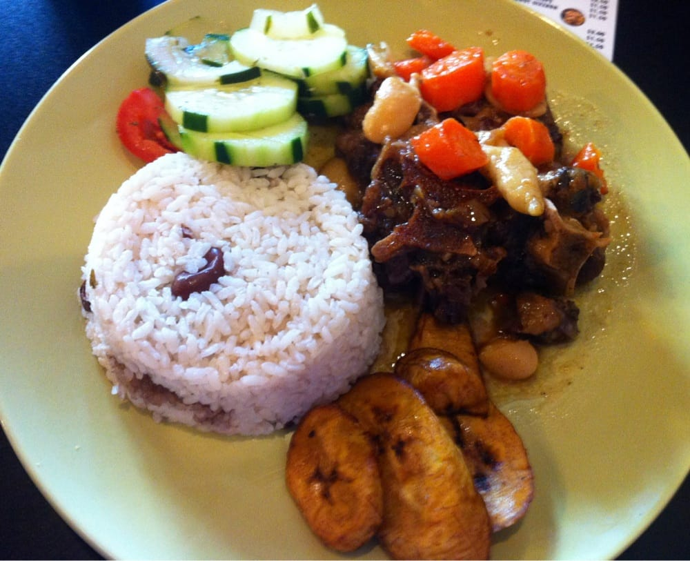 Oxtail stew with rice, cucumber salad, and plantains. | Yelp