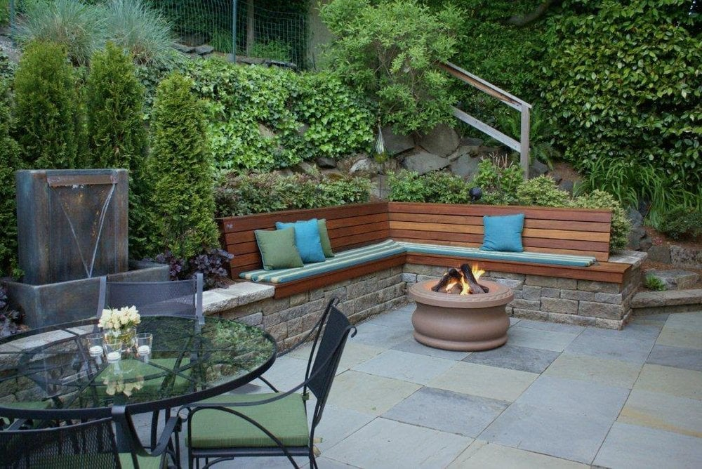 Bluestone terrace with gas fire ring water feature retaining wall ironwood bench queen - Bancos de obra para jardin ...