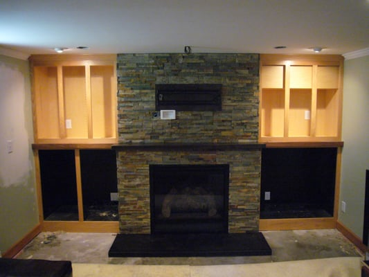 Indoor gas insert fireplace with corten steel mantle & hearth | Yelp