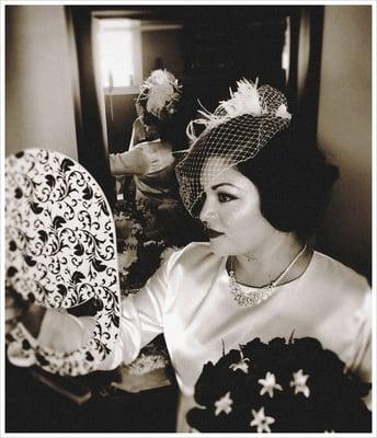 Art Deco bridal style Hair birdcage veil and fresh flowers for her hair