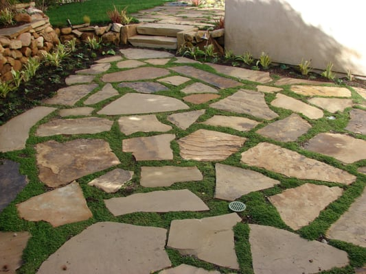 soft set flagstone patio with ground cover