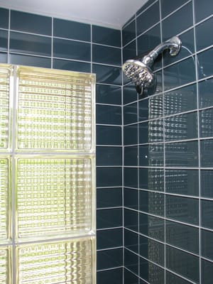 Mid Century Modern Bathroom Featuring Black Glass Tile And