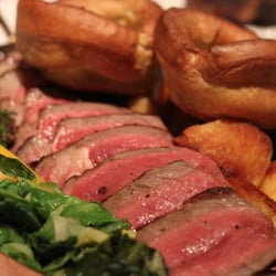 rib of beef on the bone with roast potatoes & yorkshire pudding