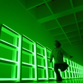 My daughter running in front of Dan Flavin