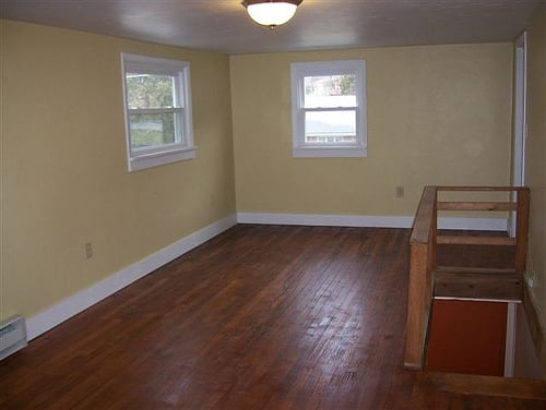 Home remodel. Upstairs bedroom w/ new walls, windows, laminate ...