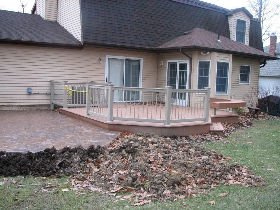 Composite decking vinyl rails and colored stamped for Concrete patio railing