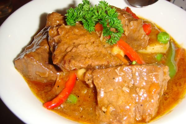 caldereta - spanish style beef simmered in tomato sauce with potatoes ...