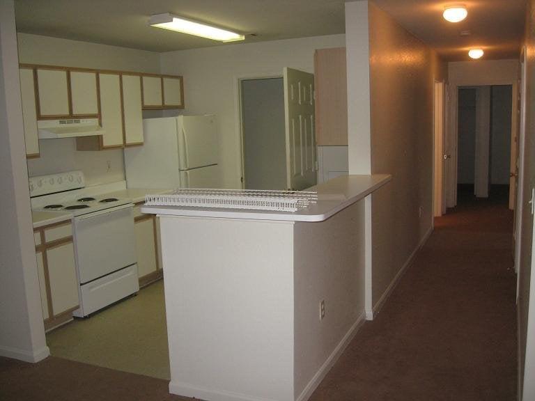 galley kitchen includes dishwasher stove refrigerator