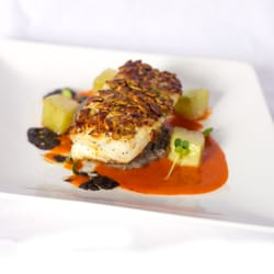PESCADO CON PEPITAS - pumpkin seed crusted seabass, corn truffle potato puree, chayote squash, guajillo chile emulsion