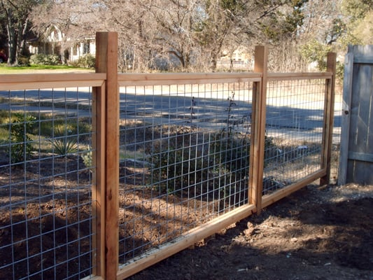 Bull wire fencing with cedar frame rustic yet beautiful for Welborn garage doors austin