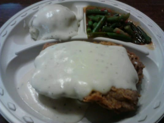 fried steak smothered in white gravy w/ mash potatoes and green beans ...