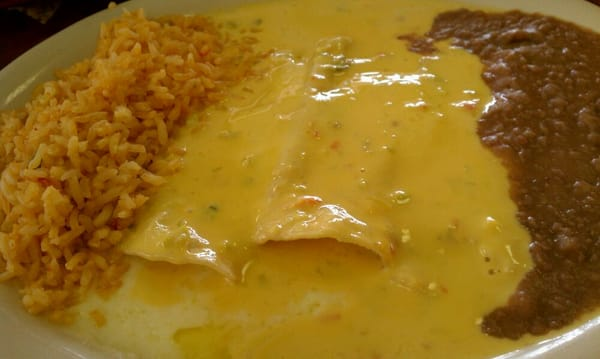 Three glorious white-cheese enchiladas. The chile con carne sauce on ...