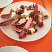 Salad with endive and blue cheese and candied walnuts.