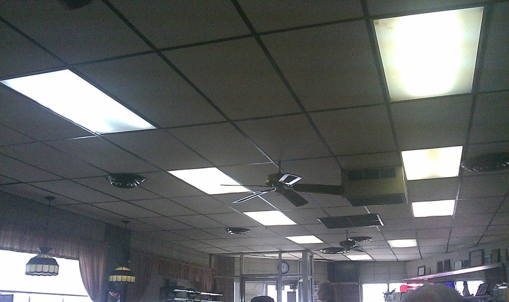 Broken Ceiling Fan : Broken ceiling fan with wires hanging out of it over a