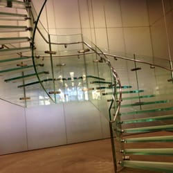 Glass stairs that make there way up to a 2nd floor!
