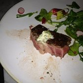 400g USDA ribeye and bone marrow butter with watercress & radish salad.