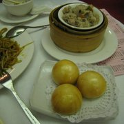 X.O. sauce noodles, steamed garlic pork ribs, fried custard-filled buns.