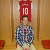 In front of Robin van Persie's locker in the dressing room.