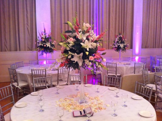 Setting up a wedding reception with tall centerpieces | Yelp
