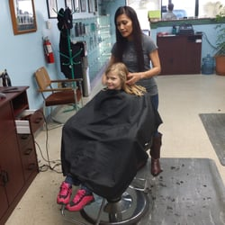 My youngest getting her hair trimmed… by Dale B.