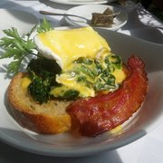 """Eggs Florentine"". Nicely prepared, their take on eggs benedict for sunday brunch."