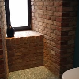 Male toilet with very nice brick work.