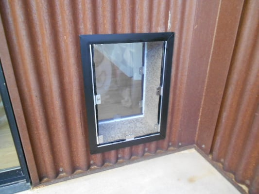 Hale Pet Door Installed Into A Corrugated Metal Exterior