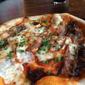 Pizza Special. Goats cheese, mozzarella, smoked pancetta, caramalised onion,