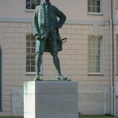 Denkmal von Captain James Cook, hinter dem National Maritime Museum