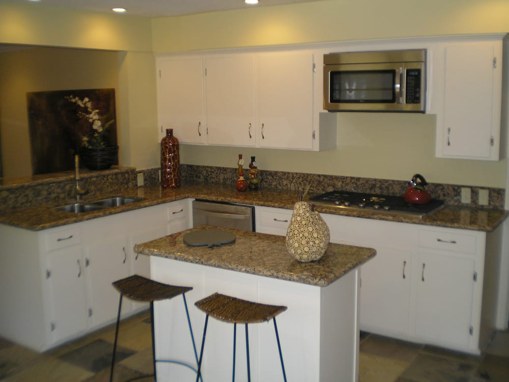 remodeled kitchen with granite countertops modern