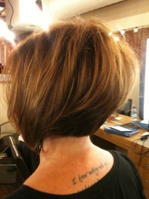 Asymmetrical soft graduated Bob with color and caramel highlights as ...