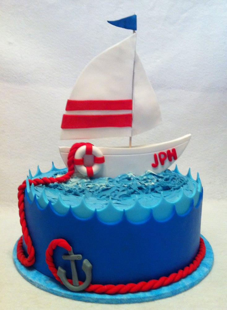 Sailboat cake for the birthday of a sailing enthusiast. Yelp
