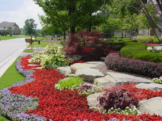 Front yard landscaping with stone retaining walls and - Flowers for the front yard ...