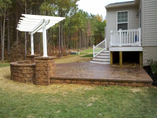 Raised patio with piers pergola fire pit and custom low for Fireplace on raised deck