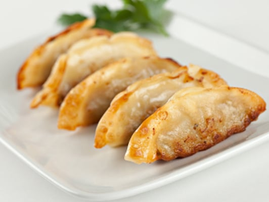 Gyoza... Pan-fried pork and vegetable dumplings with ponzu dipping ...