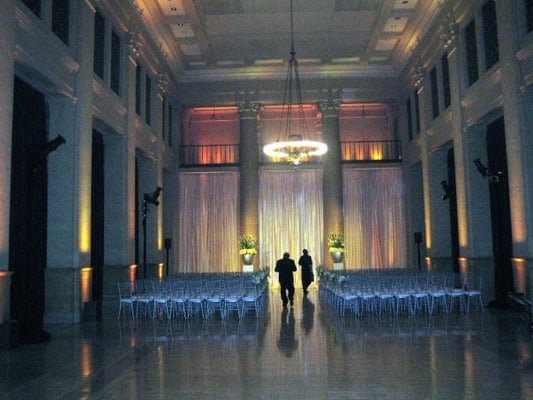 wedding ceremony tables for reception were already set and behind drapes on