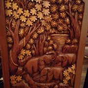 The wooden chairs hand carved from Thailand