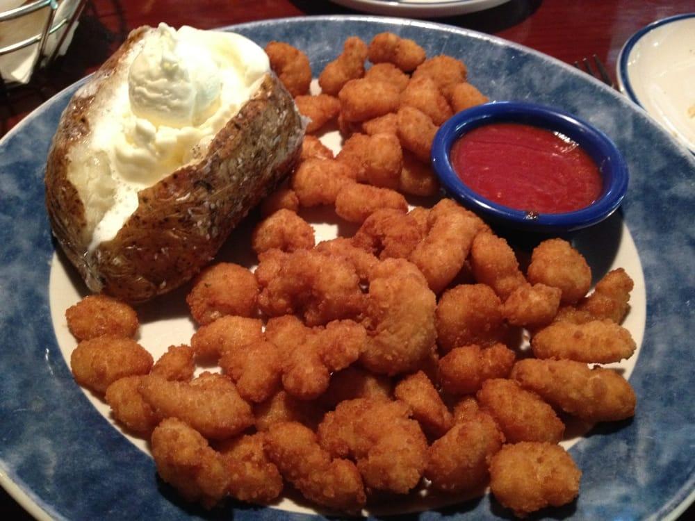 Popcorn shrimp with baked potato ..... Soooo good | Yelp