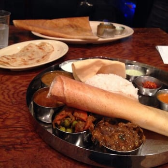 Vegetarian Thali, paratha side, & Mysore masala dosa in the back