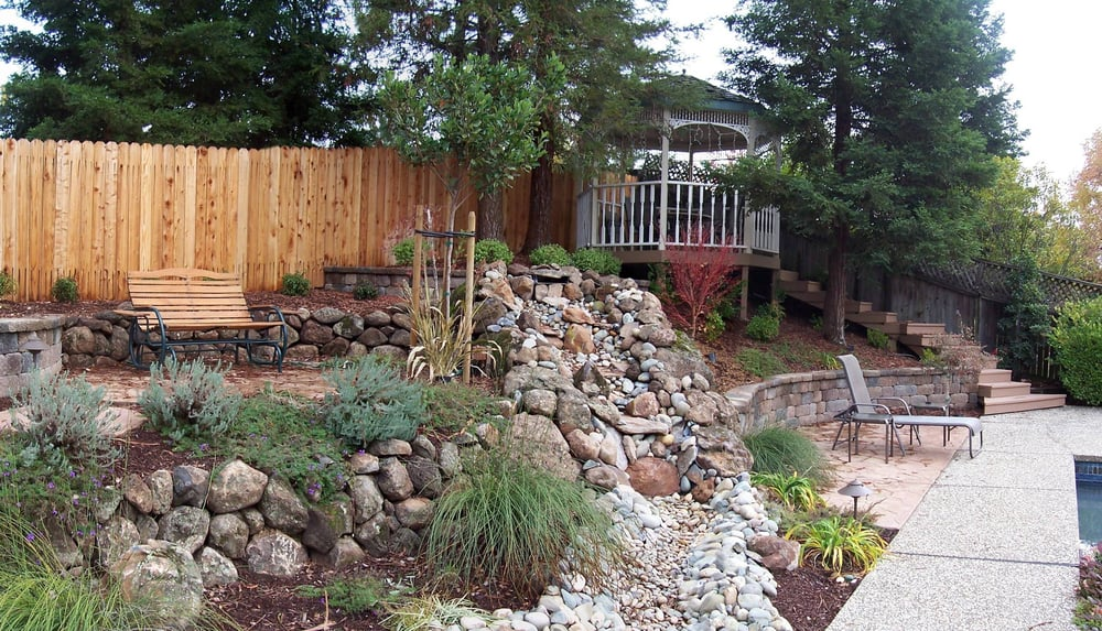 Sacramento landscaping with dry stack moss rock wall yelp for Landscaping rocks sacramento