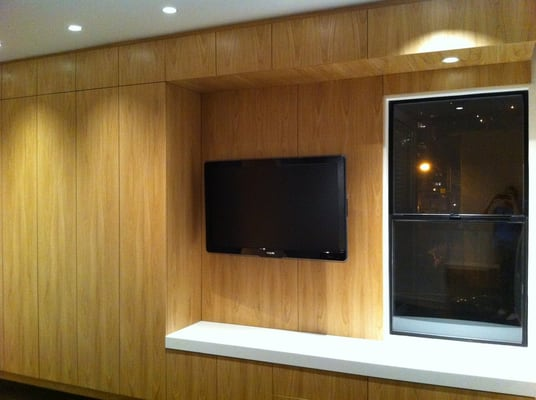 master bedroom entertainment center with floor to ceiling cabinetry