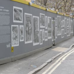 hoardings that wrap Tate Modern