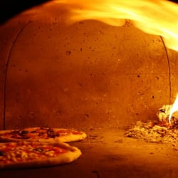 The wood fired pizza oven at The yellow house.