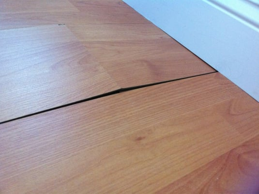 Buckling cheap laminate floor yelp for Cheap laminate wood flooring