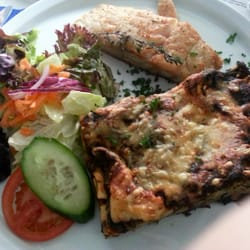 Fish with spinach lasagna and side salad