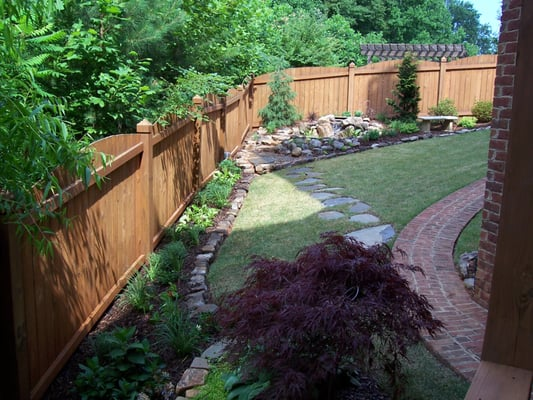Flower bed rock borders, floating flagstone walkways | Yelp