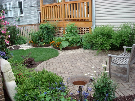 Urban Farm Backyard Ideas : Back Yard  Clay Paver Patio  Urban Farming Raised Beds  Yelp