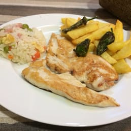 Chicken breast with small side of rice and fries/chips