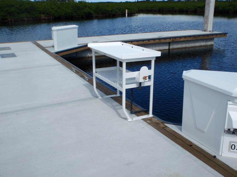 Fish cleaning tables on floating docks in ocean reef for Fish cleaning tables